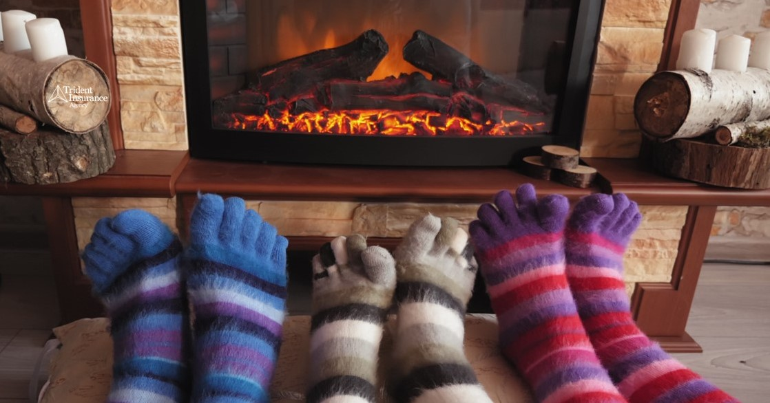 sock covered toes infront of a fireplace